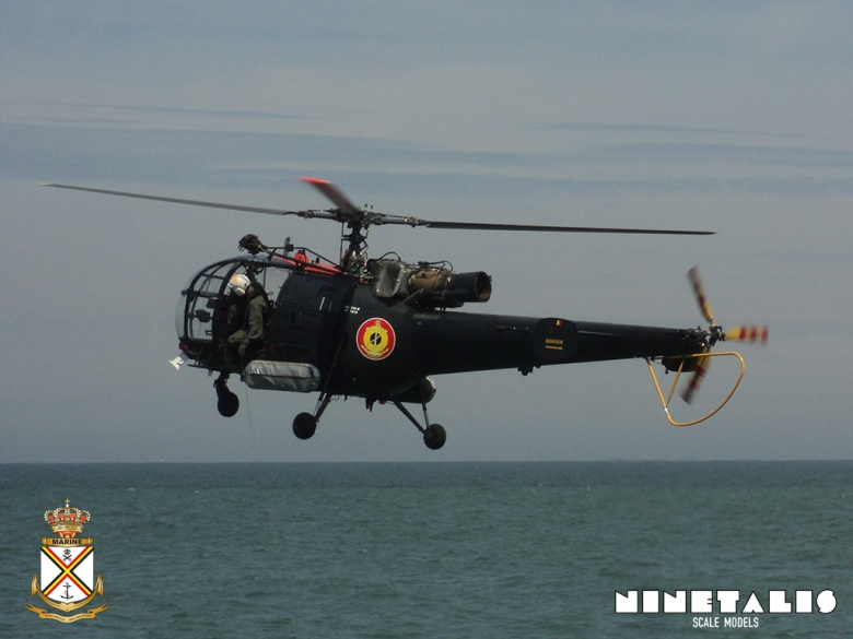 A Belgian Air Force Alouette III hovers near the Leopold I Frigate of the Belgian Navy during an exercise.