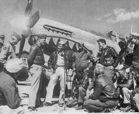 General Chennault converses with his men : pilots of 23d Fighter Group. P-51 Mustang in background. Photograph is part of the public domain.