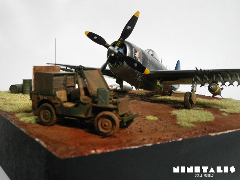 A close up of the P-47N with the Follow me Willys jeep