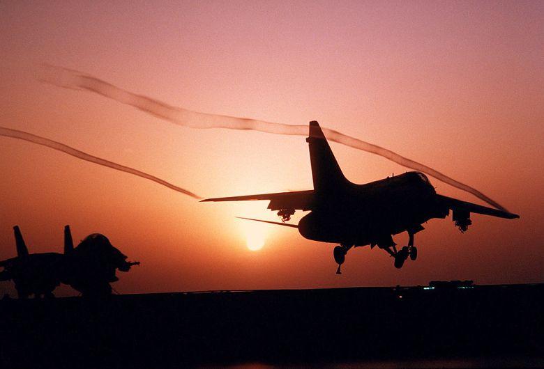 1024px-A-7E_Corsair_II_sunset