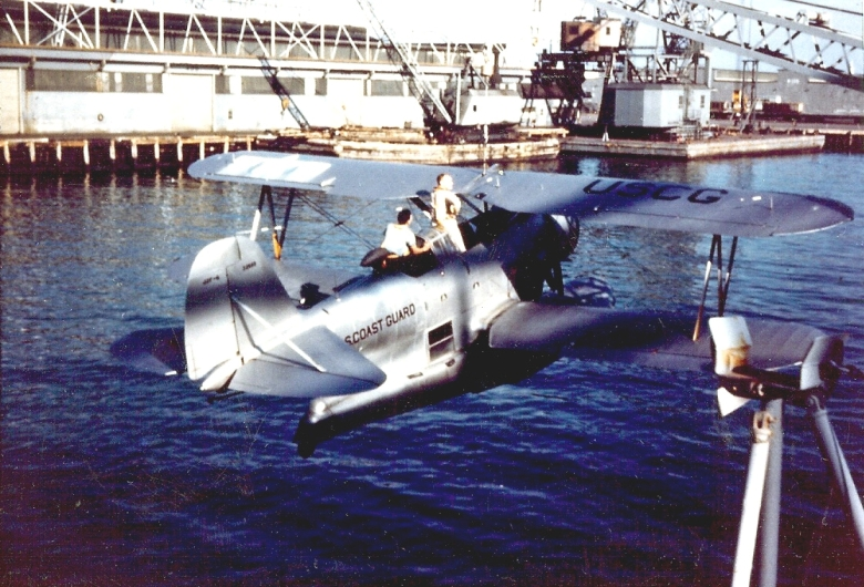 USCG_J2F-6_Duck_is_hoisted_abaord_a_ship_1946